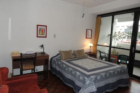This guest-house formula offers our guests the advantages of having a spacious home away from home, shared with a selected few, plus the comfort and privacy of their own space.  Steps away from La Sabana Park.  At your disposal a fully-equip kitchen.