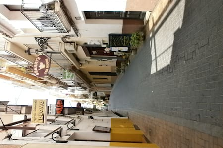 Small fully furnished 1 bed apt. could actually accommodate 4, (lounge sofa bed) situated on the 1st floor (no lift) above a t/house, which also serves breakfasts. In the heart of the old town , 2 mins from both beaches, beach beds ect available.