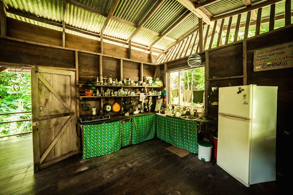 Community kitchen upstairs fully equipped with fridge, gas stove, blender and plenty of kitchen utensils.