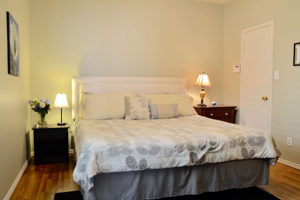 Bedroom with king-sized bed and two walk-in closets.