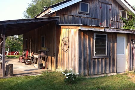 Rustic cabin  close to Highway 37 & local attractions.  Open concept, cabin loft being remodeled so queen bed and pullout couch on main floor. Covered porch, rocker & porch swing, fire pit with wood for your outdoor enjoyment. Sunday -thurs, half price with 2 night minimum.