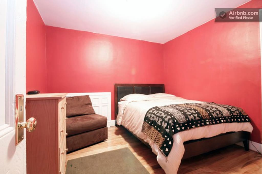 dresser, armchair, alarm clock and a Serta Perfect Sleeper queen size bed
