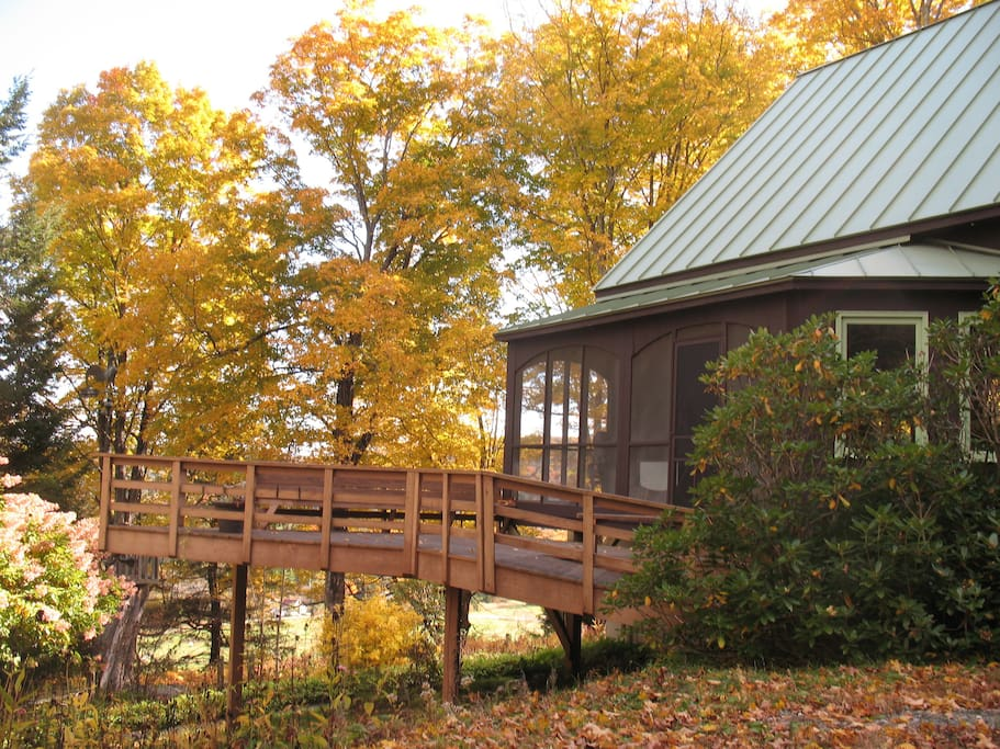 The house is surrounded by mature maple trees, especially glorious for fall folliage