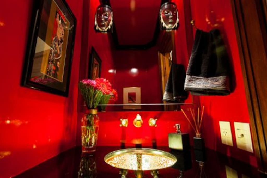 Spectacular powder room with glass under lighted sink
