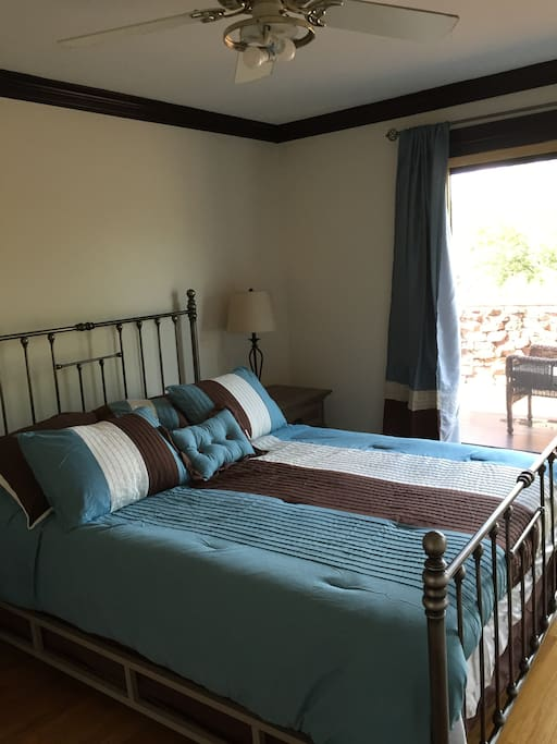 bed room 2 with sliders to balcony