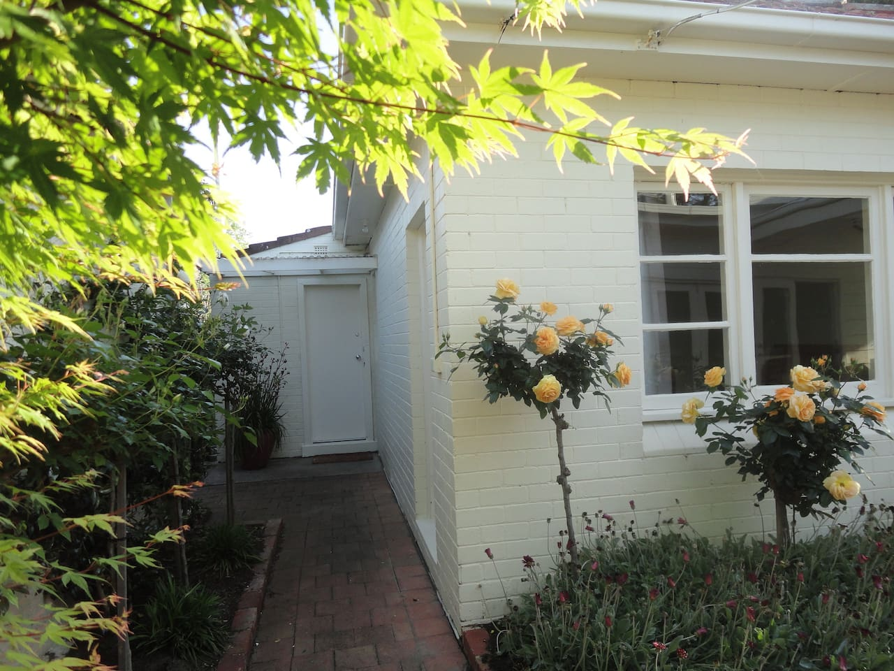 We invite you to stay in this private self contained solid brick one bedroom cottage. It is located at the back of our house, with its own separate entrance along the side of the property. This is a delightful and tranquil setting.