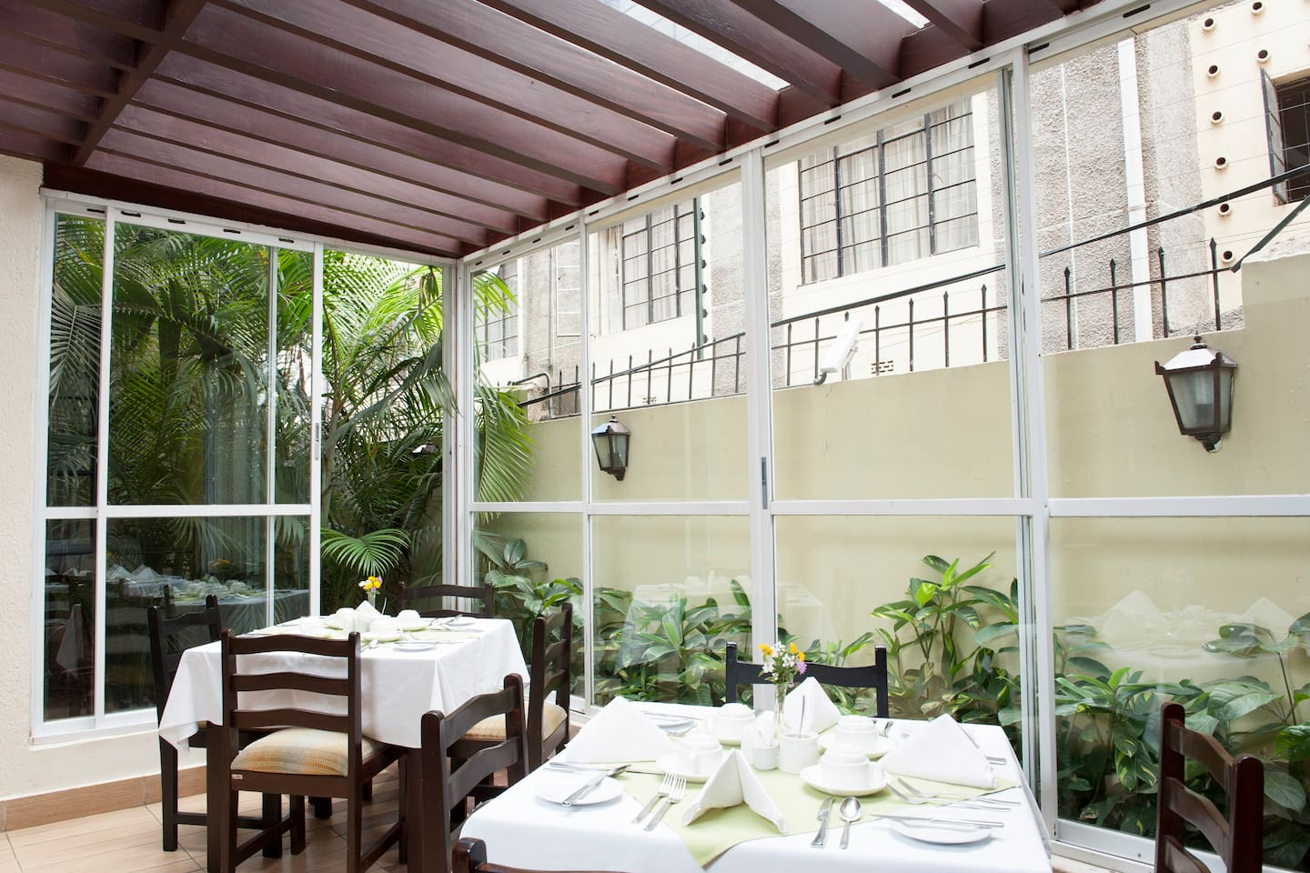 The airy and beautiful Mvuli House indoor Restaurant