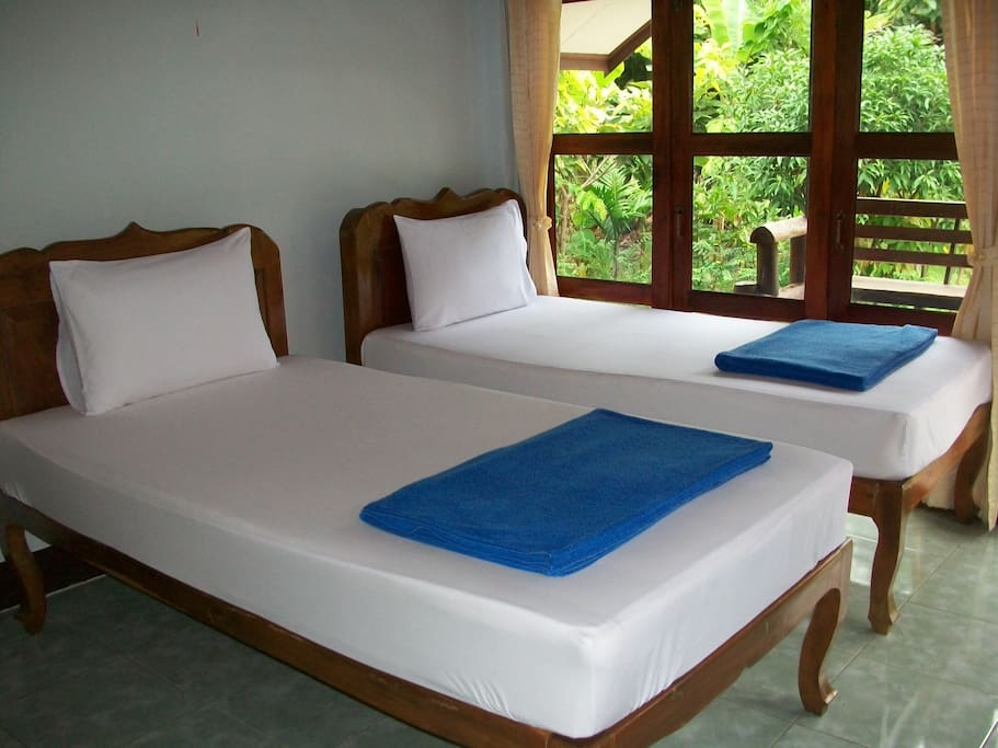 Each room has two twin beds and another can be arranged for children.