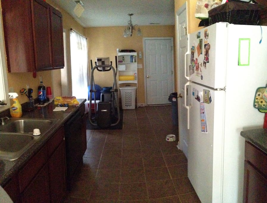 This is a view still of the kitchen, gym and laundry area (right side, past the fridge).