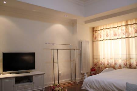 拜登观邸度假公寓(泰安万达)高级大床房 - Taian Shi - Wohnung