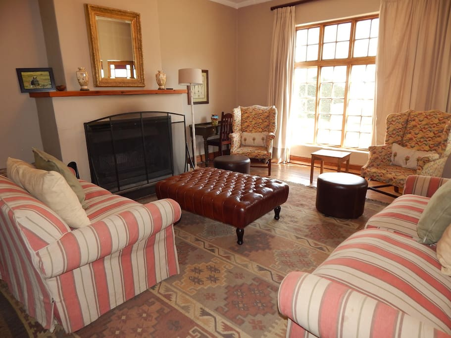 Colonial lounge with large fireplace.