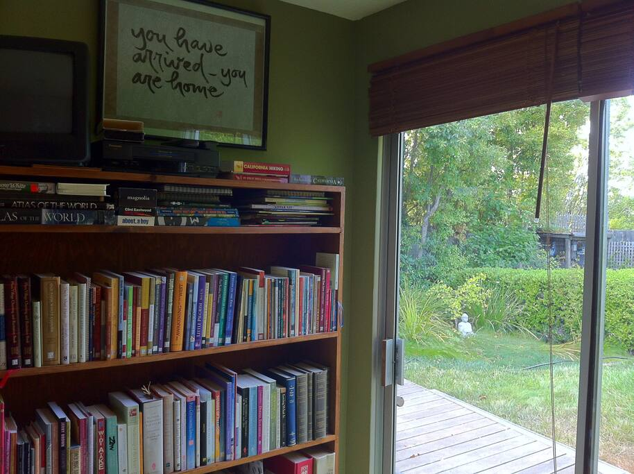 Book shelf (small TV and VCR on top) and access to garden
