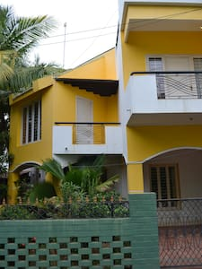 Entrance has a small garden and parking space. We have a beautiful house with a 7 meter high ceiling and large windows. Cozy room with AC bathroom and heater on first floor. Kitchen can be used to prepare meals. best to be eaten at our rooftop garden