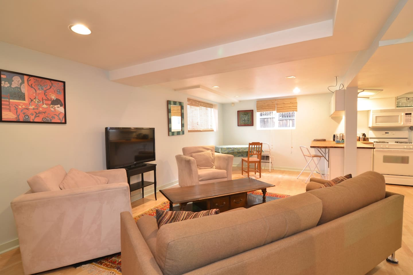 Ample living room with large TV.
