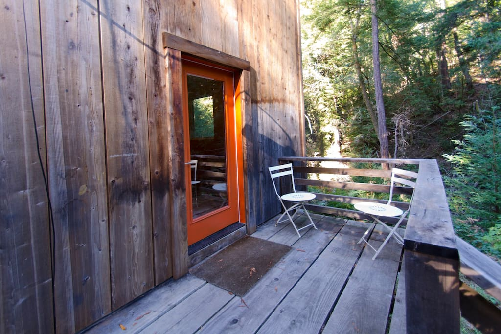 Outside separate entrance and private deck tucked into the redwood forest.