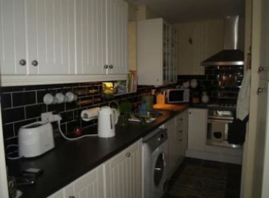 Kitchen - with washer/dryer, dishwasher, hob and oven, microwave, kettle and toaster