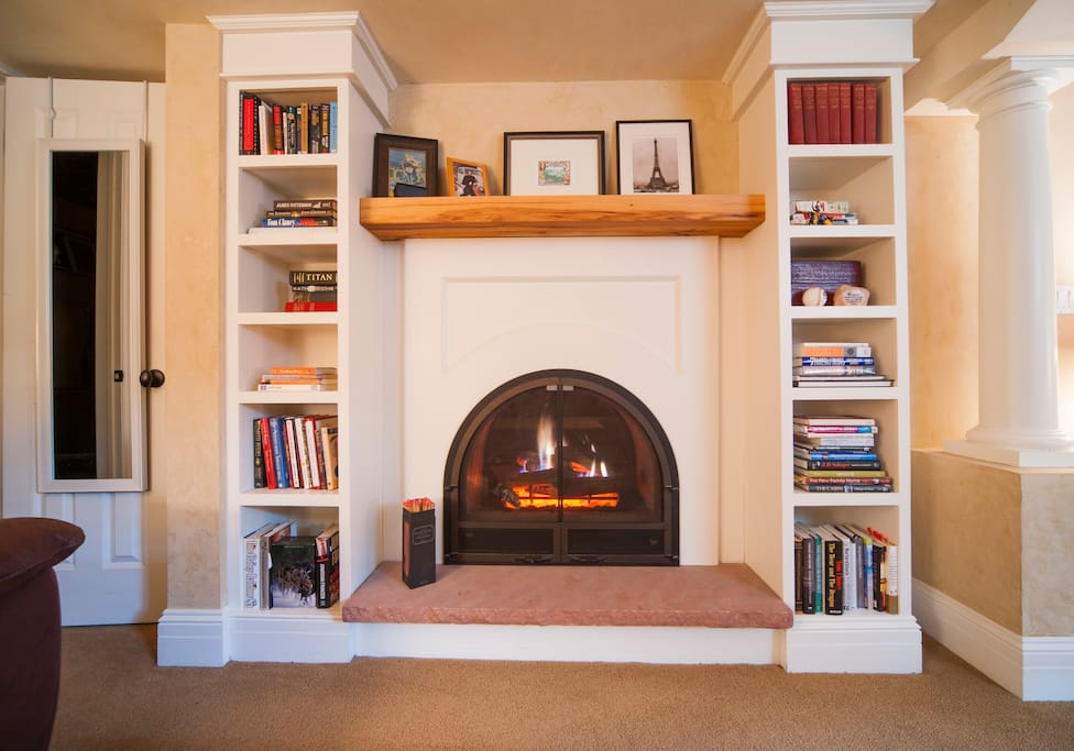 Relax by the fireplace and read one of the many books we have.