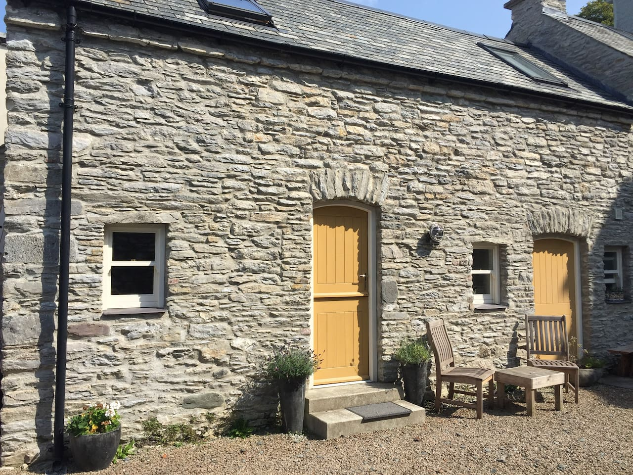 The front of the cottage has been meticulously restored stone by stone and features a stable door which opens onto the garden area which is enclosed and private from the public.