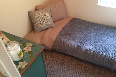 """This little room (anyone over 5.6"""" will need to bend their legs a bit) is so cute and cozy you won't want to leave! A nightstand with drawers for storage, a comfy place to sleep and a window for fresh air will have you saying, """"I want to stay!"""""""
