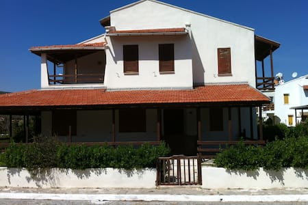 This lovely seaside villa inside security gated serene area of Urla called Gulbahce Village of Balikli Ova. It is from Cesme 25 minutes driving distance, but away from the crowds has stunning Sunsets on Aegean sea with private beach shared by the other individual homeowners of the gared community.