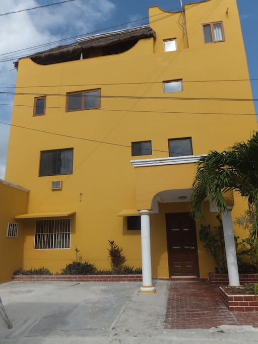 Our quaint building just 100 steps from the beach, our condo is 3rd and 4th floor