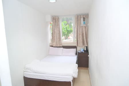 This is studio flat with private bathroom  Good for 2 people and with a window  Key area: can reach 3 MTR stations in 5 mins: Kowloon, Jordan & Austin