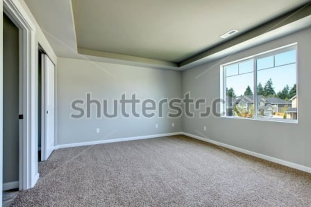 This is just a stock image I found, but it represents the layout of the room really accurately. The room is lightly furnished with a full-size bed, a table and chair, and the bathroom is stocked with the basics.