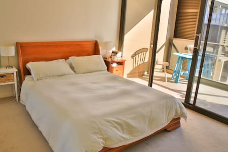 This is a beautiful, bright bedroom right on Newcastle Beach. The bedroom overlooks a courtyard, with its own private balcony. The apartment's living space overlooks the beach and is kitted out with everything you need for a comfortable stay.