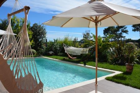 Appartement rez de jardin + piscine