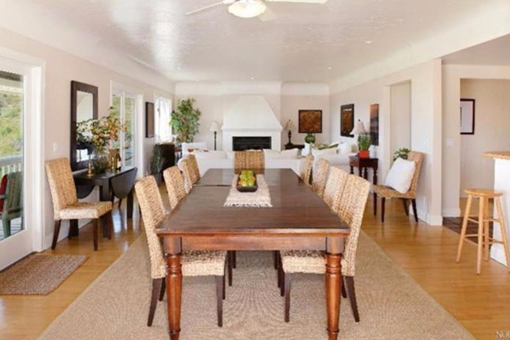 The great room boasts an expandable dining table that sits up to 12, a big comfy living room, and grand kitchen. Balcony wraps around on 2 sides.