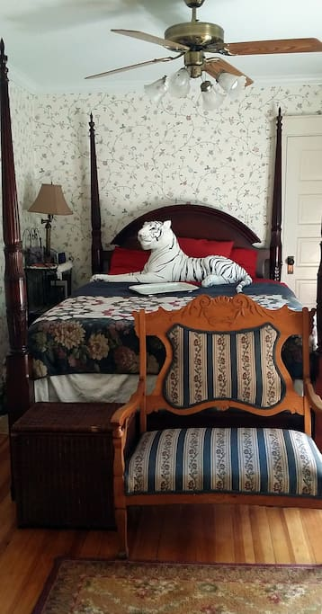 Elegant queen size bed with quality mattress in the guest room