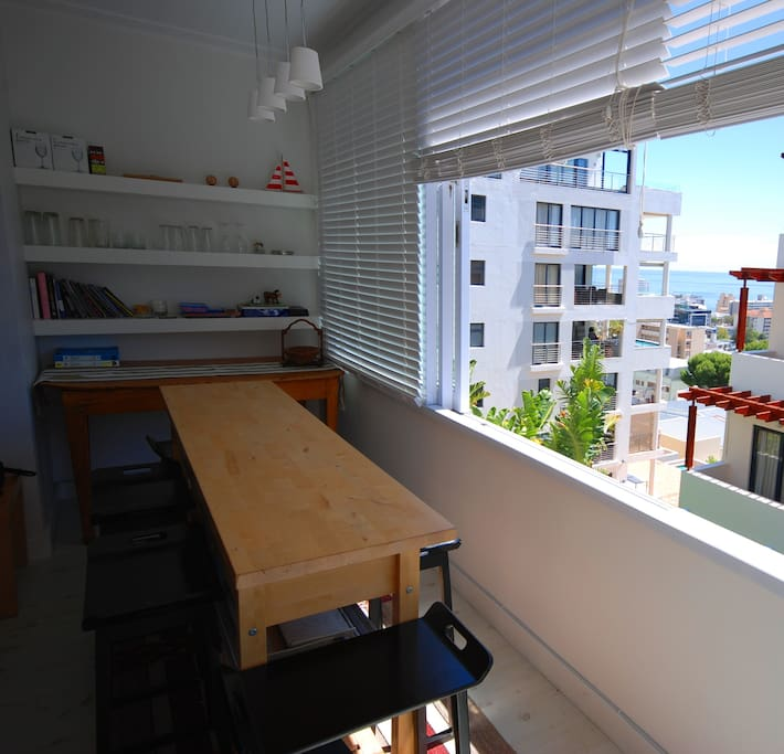 Open windows with view over the sea at the breakfast nook or late afternoon drinks counter....
