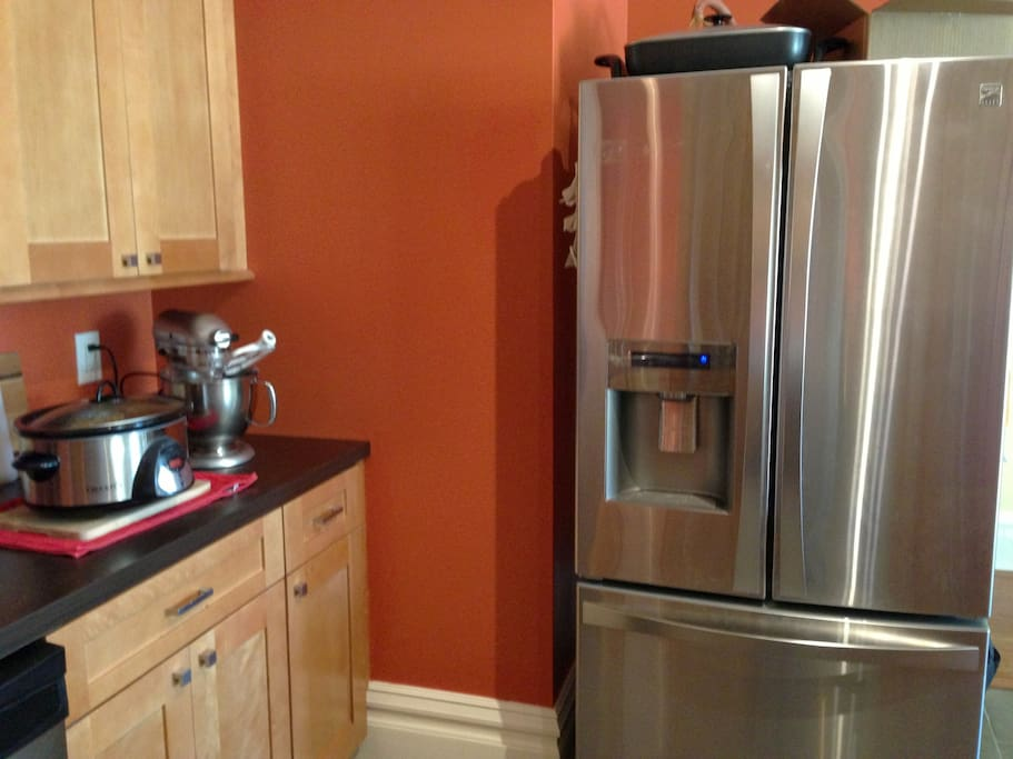 Huge stainless steel fridge with filtered drinking water.