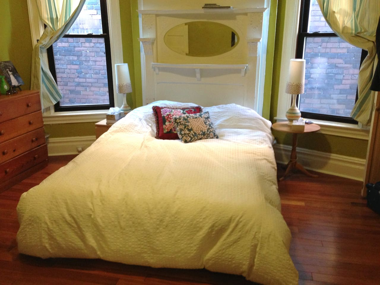 Cozy bedroom in the rear of building. We live on a busy road but put our bedroom in the back where it is cooler and quieter. We love sleeping here!