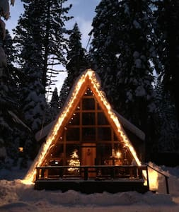 Cozy, warm and inviting anytime of year, it's the perfect getaway for family and friends. We have completely remodeled our A-Frame to its glory days of the 1950's. You will love the retro furnishings, wood fireplace, hot tub and sunny front porch!