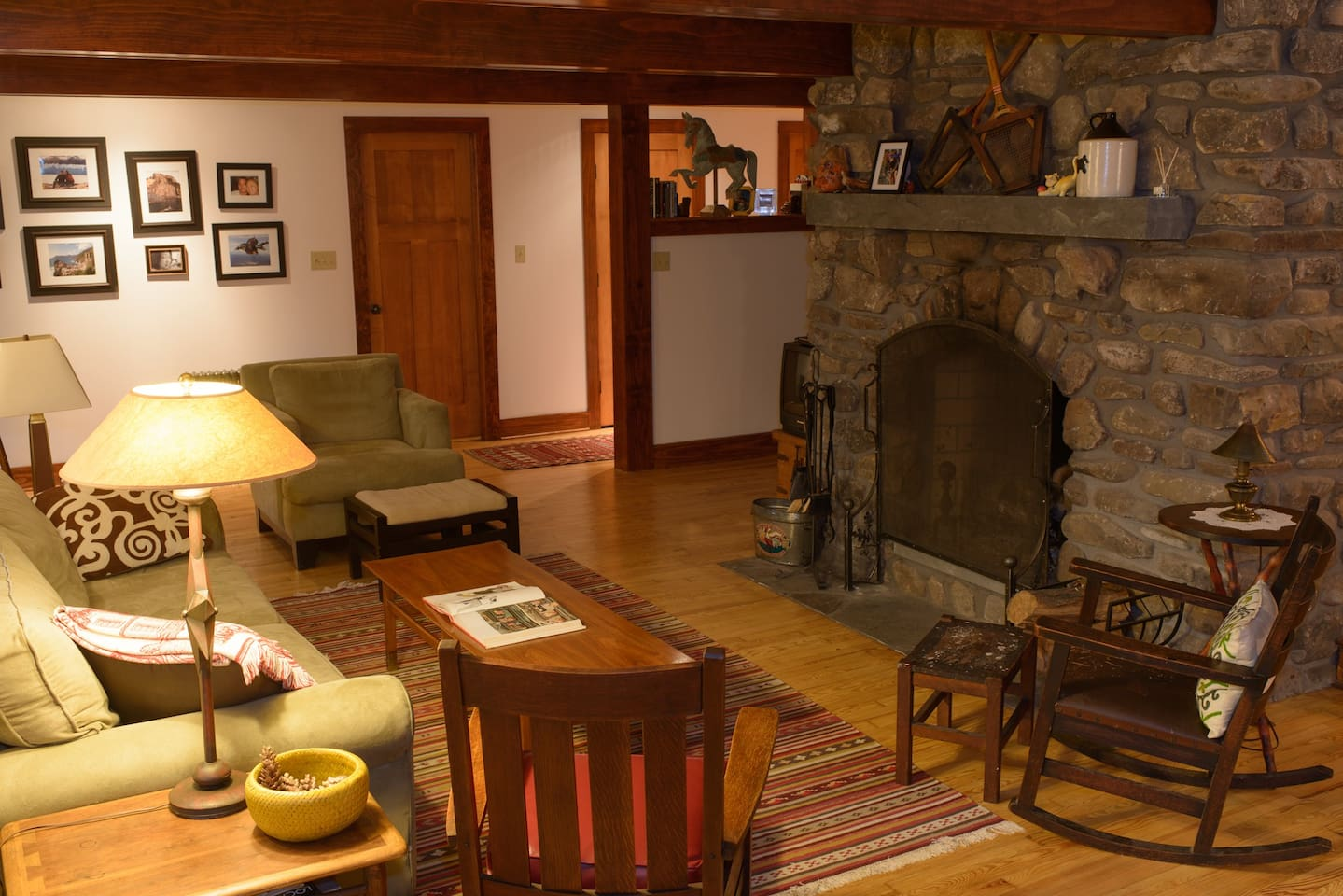 Cozy Couch, Antique Rocking Chairs, & Massive Fireplace make for an Inviting Living Room