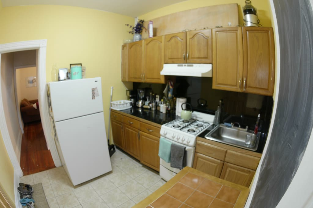 this is the kitchen! (to the right is a chalkboard)