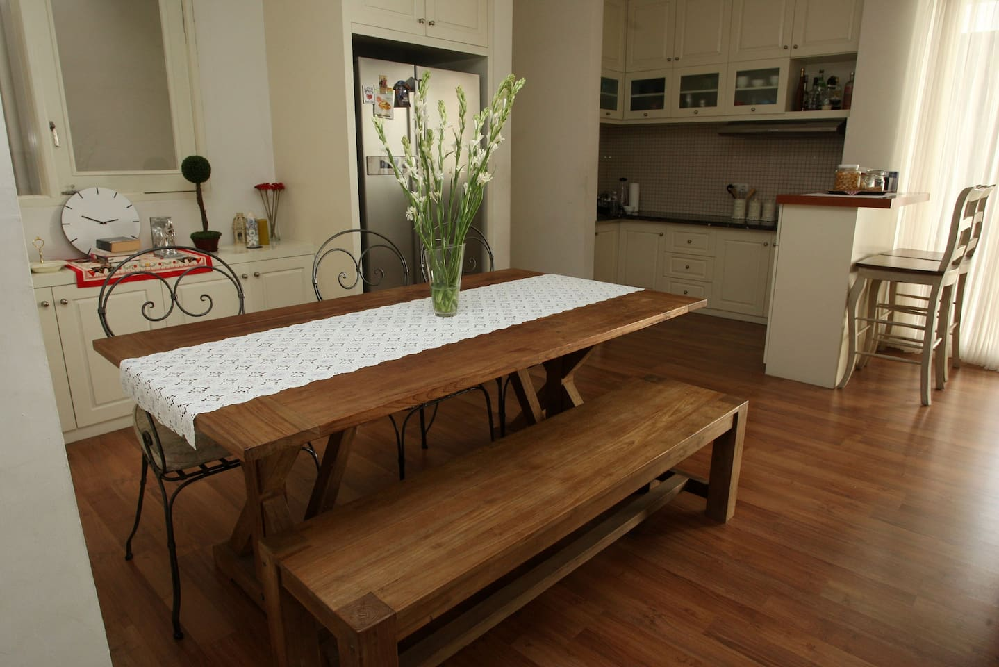 our favourite teak wood dining table. Feel free to share refrigerator and basic equipments on our pantry