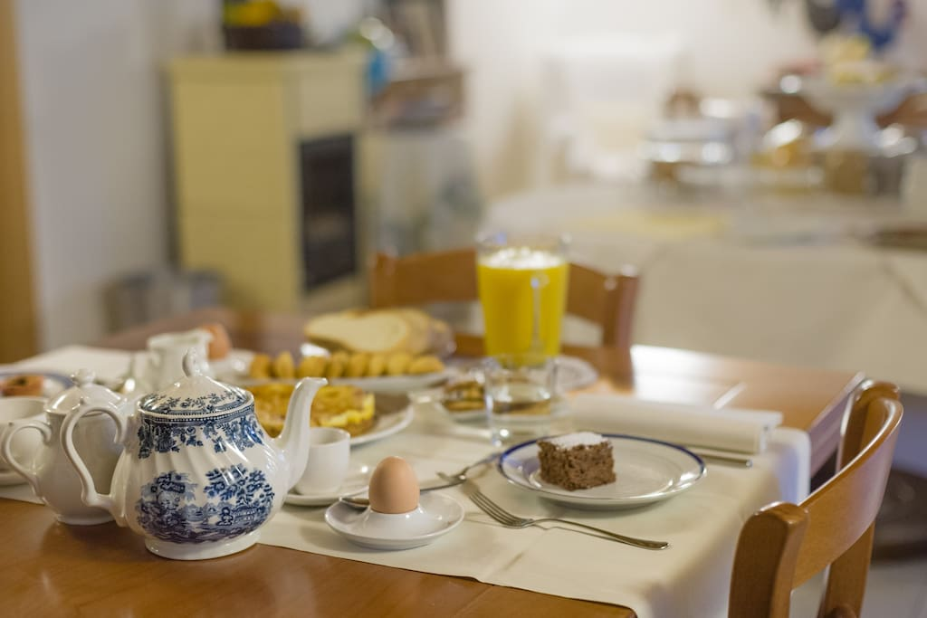 Breakfast with home made cakes, biscuits and jams, our eggs and cold meats