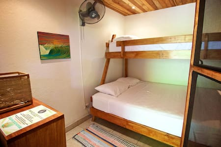 Beach Dog Hostel is the closest accommodation to the main beach entrance in Playa Guiones, Nosara, Costa Rica. Boards, bikes. snorkel and tours available.  Small, private, and comfortable room. Fast reliable WIFI.