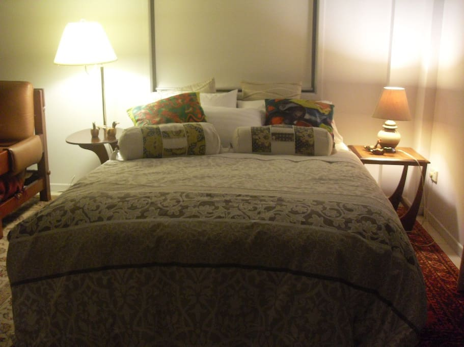 Clean and fresh bedding on double bed.