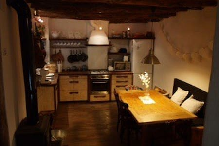 Nice large restored wooden house with Andalusian atmosphere. Located on a pedestrian street in the center, where you can experience as living in a mountain village, its unique views and happiness of people. 15 km far from ski station or Granada city.