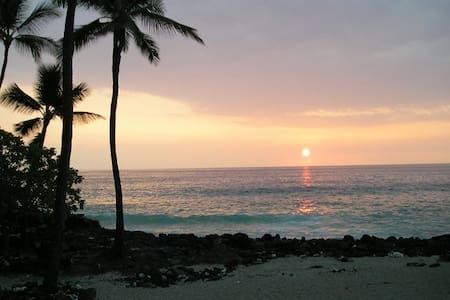 White Sands Village Condominium is across from the finest beach on the Kona coast: White Sands Beach. The locals call it 'Magic Sands.' Swimming, boogie boarding, and snorkeling in the clear blue water are a must.