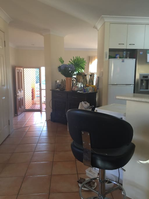 Bright and fresh open plan living. Kitchen overlooking the front portico entrance.