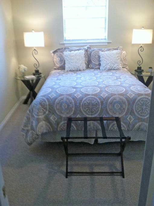 Queen size bed with firm mattress.