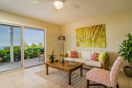 Retreat to cool temperatures after a full day of fun in the sun and enjoy the tranquility of the Big Island. Centrally located 10 minutes to town, beaches and restaurants. Downstairs unit of a duplex home with complete privacy & separate facilities.