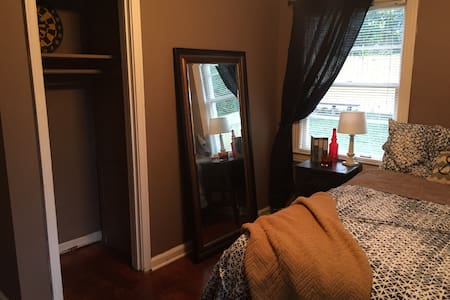 This comfortable and cozy guest room is perfect for a wonderful Nashville get away. It has its own entrance, bathroom, and lots of privacy. It is on the opposite side of the house from us and divided up by a sliding wooden door. VERY comfortable bed!