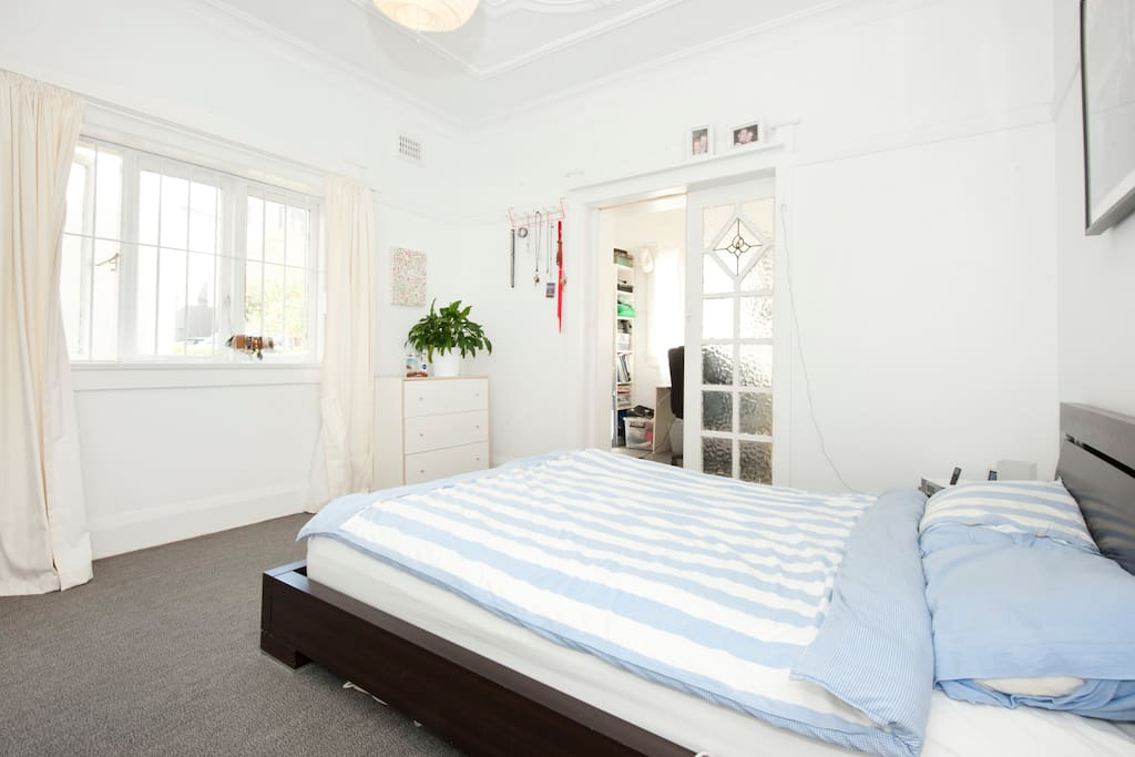 sunny bed room with access to sun room