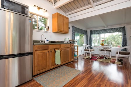 "Have your own, private little house for less than the price of a hotel room!  Rural Kona-up in coffee country, this is what some would call an ""elegant coffee shack with all the amenities."" Cool, elevated farm-like area, yet only 5 miles to town!"