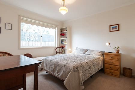 My house is a spacious  comfortable  family home with central heating/cooing and  off street parking.  There is a second small bedroom if required.  It has a beautiful outdoor living area and garden.  It is 30 minutes to the city by public transport.